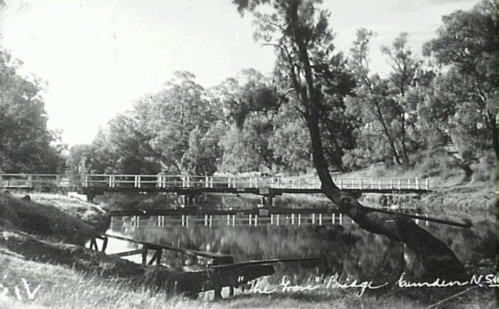 Little Sandy with footbridge across the Nepean River at Camden c.1950. This area on the Nepean River was always a popular swimming spot. Diving board in foreground. (Camden Images)