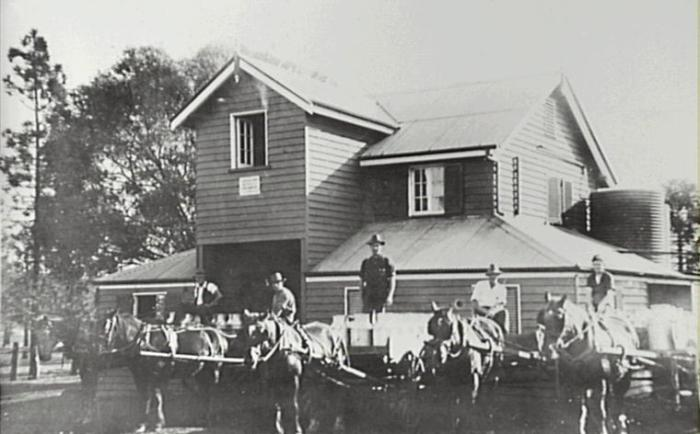 A 1926 view of Cawdor Creamery with deliveries of milk from local dairy farms