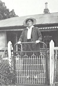 Woodbine Homestead with Rose Payten standing at gate c1920s (Campbelltown Library)