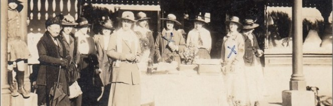 Red-Cross-Stall-outside-Whitemans-General-Store-c19201-693x221