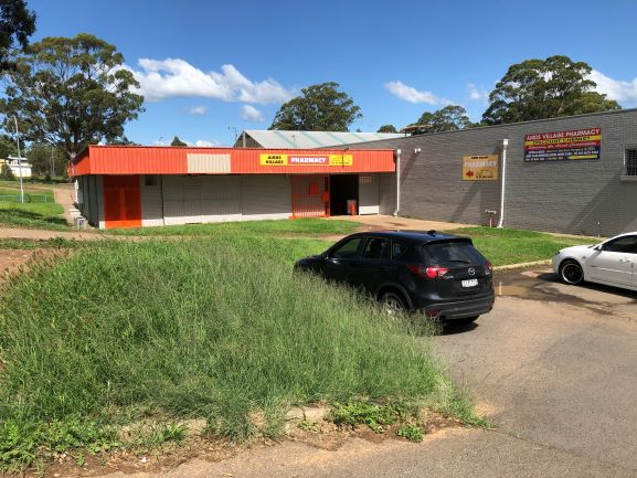 Airds Shopping Centre Front from footpath with grass 2020 IW lowres